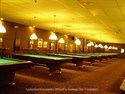 The pool room at Towne Billiards featuring 18 Brunswick Gold Crown III tables.